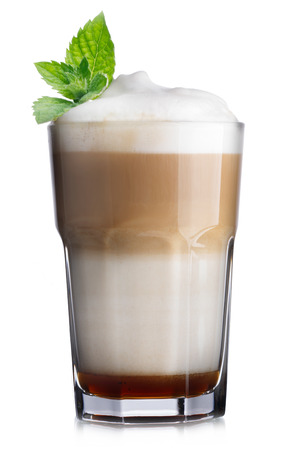 min: Glass of coffee cocktail with chocolate syrup and foam decorated with min leaves
