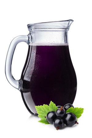 Fresh blackcurrant juice in a pitcher