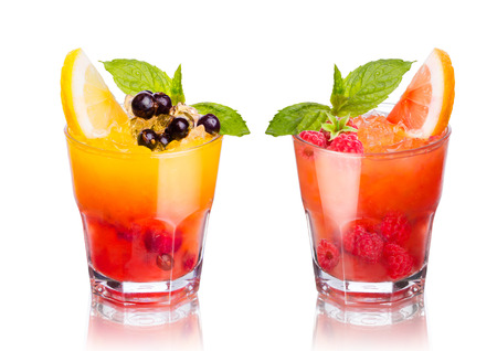 Two summer alcoholic cocktails isolated on white