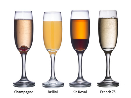 bellini: Collection of most popular alcoholic cocktails with sparkling wine: Champagne, Bellini, Kir Royal and French 75 in flute glasses. Stock Photo