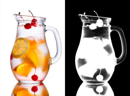 misted: Alcoholic cocktail with orange in misted pitcher decorated with cherries. Transparency mask (alpha channel) included Stock Photo