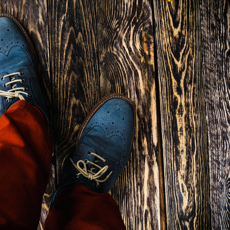 brogues: Man wearing orange radiant pants and blue suede shoes