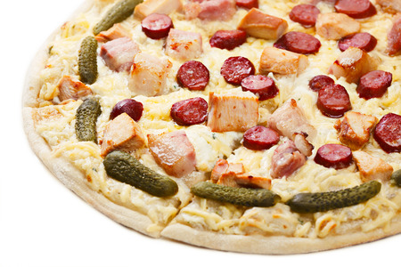 gherkins: Close up of sliced pizza with chicken, meat and gherkins