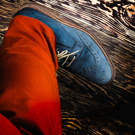 Close up of mens brogues (also known as derbies,gibsons or wingtips) made from blue oiled suede