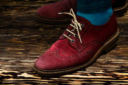 wingtips: Close up of marsala colored mens brogues (also known as derbies,gibsons or wingtips) with opened lacing Stock Photo