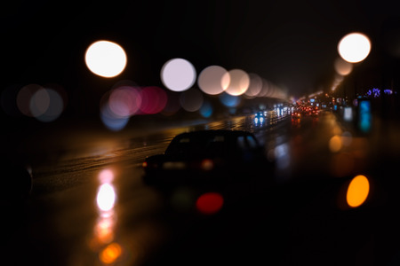 flickering: Out of focus evening highway lights background.