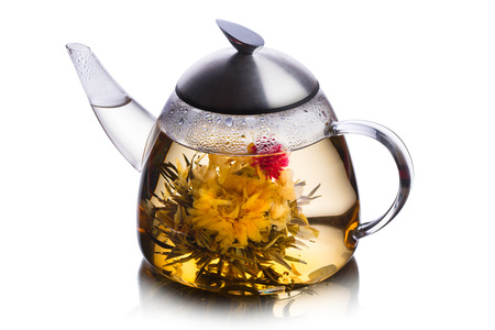 Teacup full of herbal tea with blossoming flower. Healthy eating. Sun tea