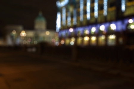 evening out: Out of focus evening city lights background. St Petersburg, Kazansky Cathedral Stock Photo