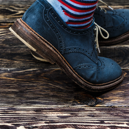oiled: Close up of mens brogues (also known as derbies,gibsons or wingtips) made from blue oiled suede
