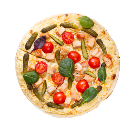 gherkins: Top view of pizza with tomatoes, meat and gherkins decorated with leaves