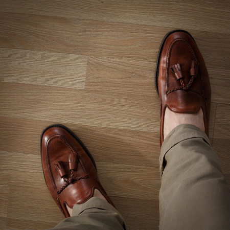 cushioned: Sockless male legs in tasseled loafers