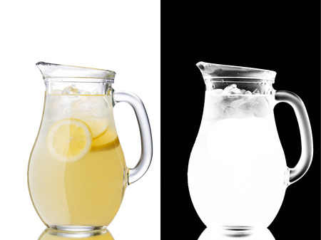 Lemonade pitcher isolated on white. Transparency mask included