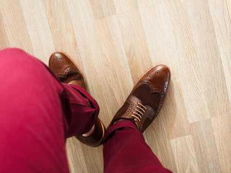 cushioned: Stylish dressed man wearing cushioned pants and wingtips