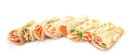 Big collection of elegant,neat, gourmet stuffed savory crepes decorated with herbs Banco de Imagens