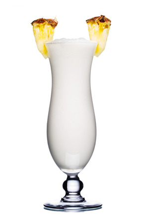pineapple  glass: Milk cocktail in hurricane glass decorated with pineapple slices