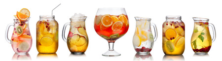 cold drinks: Collection of different summer party drinks in bulk glasses. Pitchers,jugs and jars filled with sangria,spritzers,detox and infused waters. Stock Photo