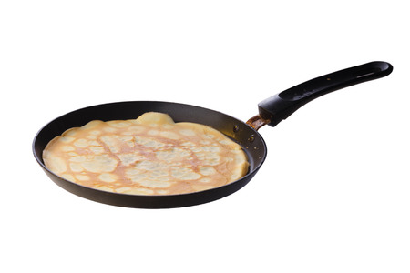 pan: Crepe (blin) on a frying pan Stock Photo