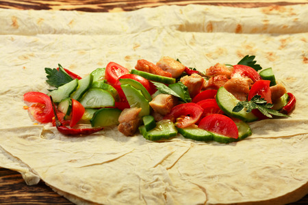 unwrapped: Traditional shawarma with chicken and vegetables in unwrapped condition