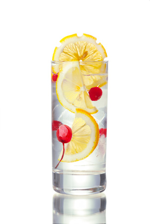 longdrink: John Collins alcoholic cocktail in highball glass decorated with lemon slice.  Stock Photo