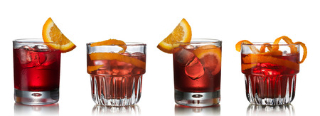 Set of Negroni alcoholic cocktail decorated with orange twist.  Standard-Bild