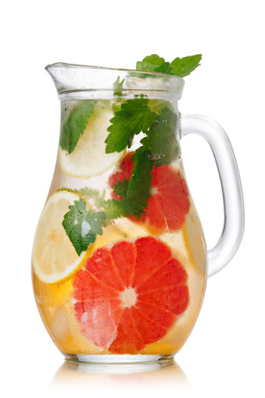 Jug of lemonade with lemon balm and grapefruit