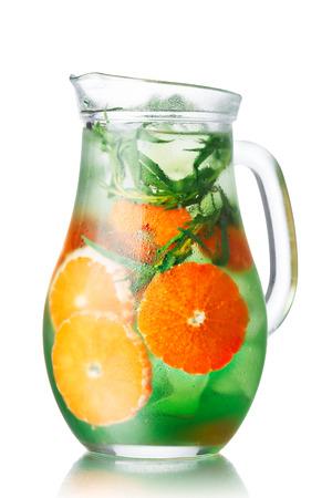 tarragon: Glass pitchers with tangerine tarragon  (tarkhun) infused detox water Stock Photo