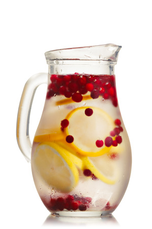 cowberry: Cranberry lemon detox water in a glass jug. Healthy water with infused cranberry, cowberry and lemon