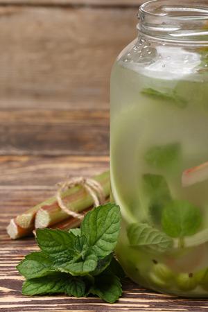 fat burning: Pitcher of rhubarb gooseberry mint detox water or lemonade. Healthy eating