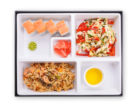 sectioned: Japanese lunch box. Top view of sectioned plastic box with Japanese food.