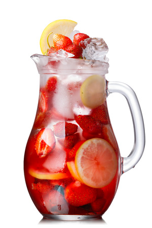 Strawberry lemon detox iced water in a glass jug. Healthy, clean eating
