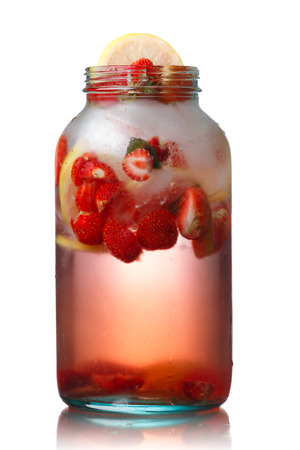 fat burning: Strawberry lemon detox iced water in a glass jar.  Infused water. Healthy, clean eating