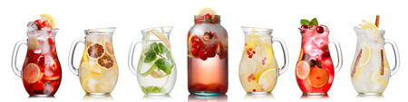 rhubarb: Collection of different drinks in glass jugs and jars. Glasses full of spritzers, schorle,lemonade,iced tea, detox waters. Healthy eating