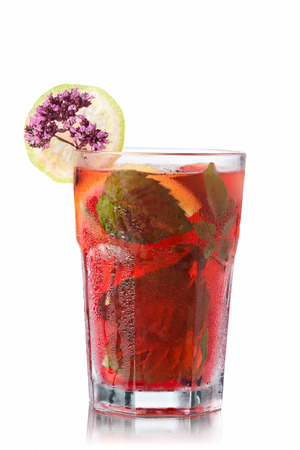 wild marjoram: Strawberry mojito garnished with lime slice and marjoram (wild oregano) Stock Photo