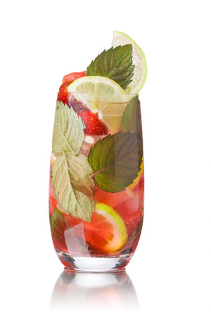 origanum: Strawberry mojito garnished with lime slice and fresh mint leaf Stock Photo