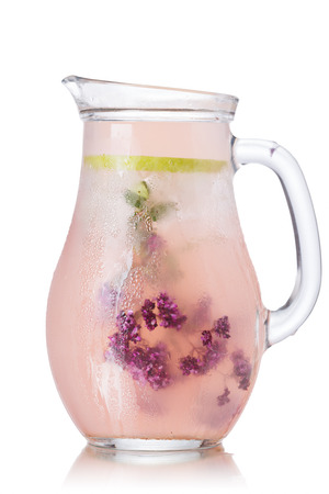 wild marjoram: Blossoming oregano infused water. Pitcher of iced detox wated with wild marjoram (oregano)  Clean eating concept