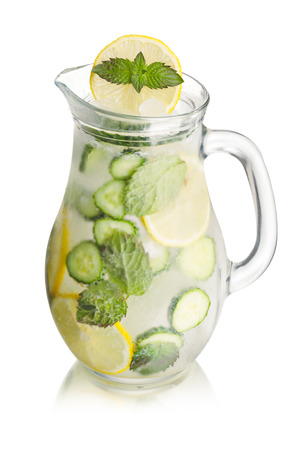 seltzer: Sparkling cucumber lemonade in a glass pitcher. Refreshing summer soda with lemon, mint and cucumber