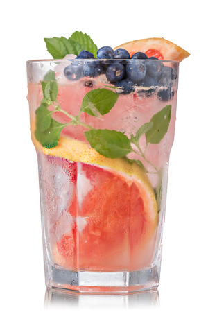 highball: Grapefruit mojito cocktail in faceted highball garnished with blueberry. Refreshing summer drink with rum,grapefruit and fresh mint