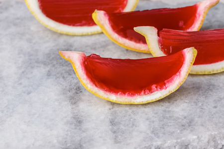 fruit of the spirit: Lemon tequila strawberry jelly (jello) shots on a marble plate. Unusual adult party drinks Stock Photo