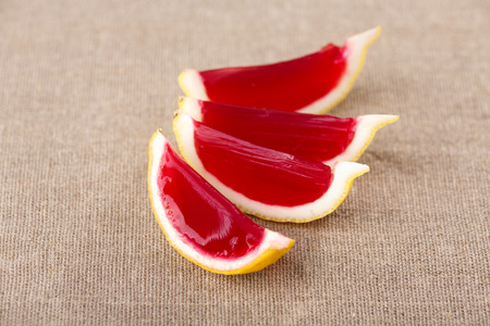 jello: Lemon tequila strawberry jelly (jello) shots on a linen clothed table. Unusual adult party drinks