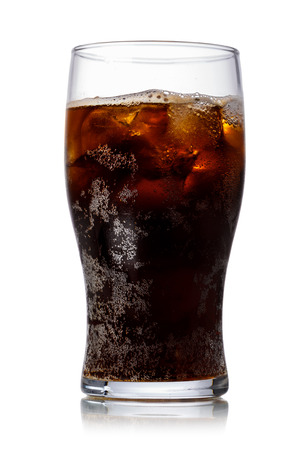 malto d orzo: Malta soda (soft drink) in a glass with ice. Lightly carbonated malt beverage, brewed from barley and hops. Also known as Malzbier, malztrunk,kinderbier. Archivio Fotografico