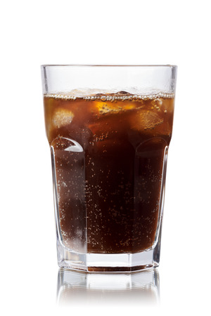 nonalcoholic beer: Malta soda (soft drink) in a glass with ice. Lightly carbonated malt beverage, brewed from barley and hops. Also known as Malzbier, malztrunk,kinderbier. Stock Photo