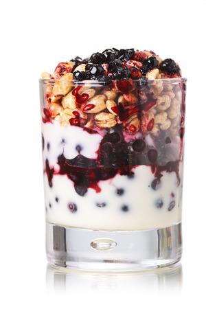 bilberries: Parfait-style healthy layered snack or dessert with yogurt,bilberry jam,fresh bilberries,puffed honey wheat in glass
