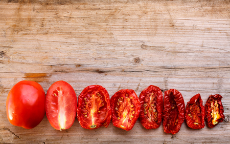 dehydrated: Sequential stages of tomato drying from fully fresh to almost dehydrated