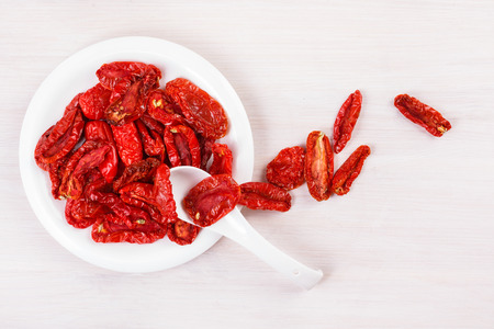 sun dried: Sun dried tomatoes on bleached wooden table Stock Photo
