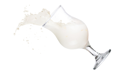 falling down: Milk alcoholic cocktail in hurricane glass falling down Stock Photo