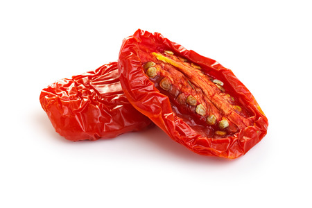 Sun dried tomatoes isolated on white with smooth shadow 免版税图像
