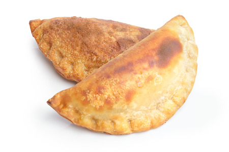 and savory: Isolated savory empanada. Savory patty. Large depth of field
