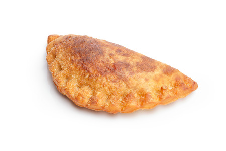 colombian food: Isolated savory empanada. Savory patty. Large depth of field