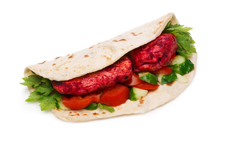 naan: Chicken Tikka masala naan sandwich. Indian takeaway. Studio shot, infinte depth of field