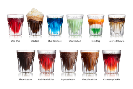 Set of labeled isolated alcoholic cocktails in shot glasses (shooters)